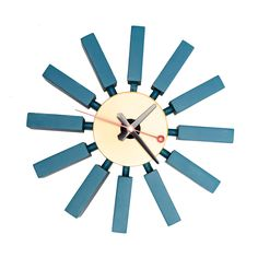 Brighten up your timekeeping with this retro teal wall clock. Based on a classic 1950s design, bright wood blocks extend from the clock face in rays to mark the hours and make a strong style statement on your wall.