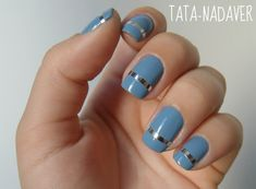 Nail art:  Blue nails with silver foil stripe