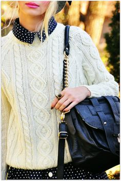 .Love this creamy colored sweater and black purse.
