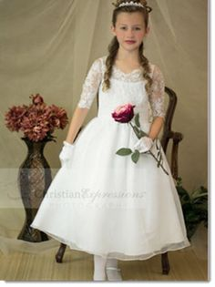 8021 Melanie Classic style first communion dress with lace bodice and three quarter fitted sleeves.