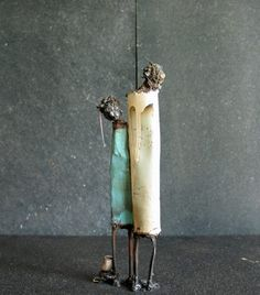 Mother + Child by Johan Jonsson  23x50x50 cm -   sheet-metal, forged nails, paint tube, weld