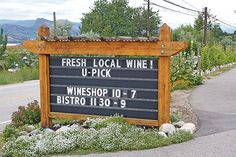 Sometimes it's a smile or a chuckle and other times a full on belly laugh as drivers and cyclists on Naramata Road slow down to take in Hillside Winery & Bistro's ever changing clever signs: Fresh local wine! U-pick, Love the wine you're with! If you walk a mile in my shoes…you will be at a wine bar. When life gives you lemons – sell them to buy wine, Are you celebrating Canada Day…with red, white & ros-eh?… These funny signs serve a serious purpose. They reflect Hillside's take that their…