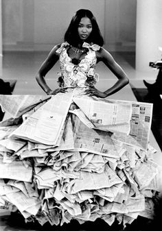Model Naomi Campbell wearing a wedding dress made from newspapers and dollar bills as part of the New Renaissance collection at the Harvey Nichols and Perrier New Generation Designers Show, 1994