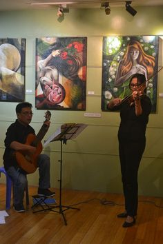 """Gig in an Art Exhibit opening """" Diffsuasion"""" st SM Megamall with my guitarist and painter friend."""