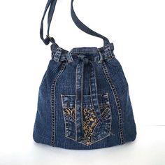 Recycled bucket bag, Denim drawstring bag, Jean crossbody bag,Upcycled side purse, Teens travel bag, Veagn fashion, Denim weekend tote purse by Sisoibags on Etsy https://www.etsy.com/listing/333527068/recycled-bucket-bag-denim-drawstring-bag