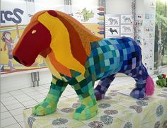 Lion yarn-bombed for International Yarn Bombing Day