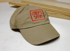 Chief's Shop Hat  khaki twill with hook and loop strap, red embroidered logo