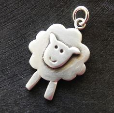 Cute sterling silver sheep necklace in a sterling silver rolo chain. The little sheep is handmade in my design and has a matt finish. It is about 2.0 x 1.5 cm (0.8 x 0.6 inches). The chain is either 40cm/16 or 45cm/18 long.  Enter my shop here: http://www.etsy.com/shop/fingerprince
