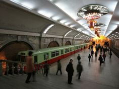 Commuters wait to board a subway train at a station in Pyongyang, North Korea, March 30, 2005.