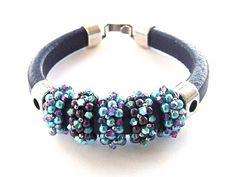 Beadwork around licorice leather bracelet ~ Seed Bead Tutorials.