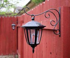Solar lights on plant hooks.