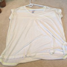 SEE SALE Free People White Tshirt super soft, NWOT never been worn, white with neon yellow stitching on the inside, sleeves have a cuffed look, xsmall but can fit up to a medium, loose fit Free People Tops Tees - Short Sleeve