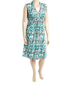 Look at this #zulilyfind! Green & Black Zigzag Surplice Pocket Dress - Plus #zulilyfinds