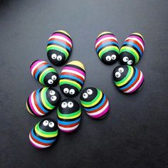 cute! - color bugs - painted rocks in rainbow brights with googlie eyes - would make cutie cute fridge magnets!
