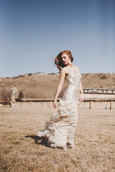 wedding dress fluttering in the wind // photo by Sara K Byrne Photography