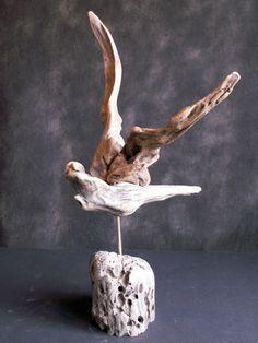 Driftwood bird in flight