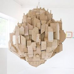 In need of some out-of-the-box artistic inspiration? Swedish artist and illustrator, Nina Lindgren, has more than just a way with cardboard -- her Floating City cardboard sculpture is a thought provoking work of art. Cardboard City, Cardboard Sculpture, Cardboard Paper, Art Sculpture, Cardboard Crafts, Cardboard Houses, Mr Printables, Instalation Art, Invisible Cities