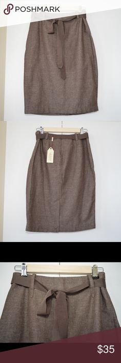 NWT Max Studio Specialty Products Linen Skirt NWT Max Studio Specialty Products Linen Skirt. Color is Brown (with flecks of White). Size 2. 55% Cotton and 45% Linen. Pencil style with center back zipper and slit, belt loops with ribbon belt, fully lined. Max Studio Skirts