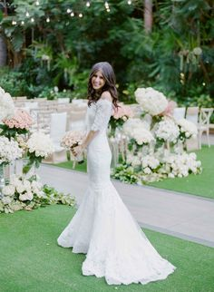 Bride in Off-Shoulder Lace Mermaid Gown   Photo: Amy & Stuart Photography.  View More:  http://www.insideweddings.com/weddings/rustic-elegant-outdoor-ceremony-luxe-garden-inspired-reception/869/