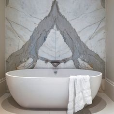 Marble wall with white bath