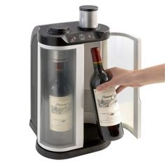 Too expensive for a Christmas present but I definitely want one of these at some point. :P  Wine Enthusiast EuroCave SoWine Home Wine Bar (Silver Trim Door)
