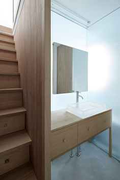 Itami House by Tato Architects, wood closet as stairs | Remodelista