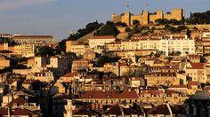 Castelo Sao Jorge (Castle Saint George) dominates the Lisbon skyline.