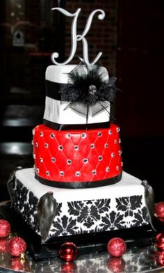 """Red, Black & White Wedding Cake. Not sure how I feel about the red part. It kinda looks like cheap leather. And of course it'd need an """"A"""" on top"""