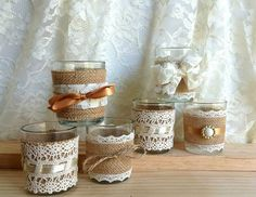 "6 burlap and lace covered votive tea candles and vase country chic wedding decorations, bridal shower decor, home decor, gift or for you NEW  6x natural color burlap, natural color and white lace covered votive candle holders. 6x ivory votive candles. 1x natural color burlap and natural color cotton lace covered vase.  Votive Holders Made of Glass Size: 2 diameter x 2.5"" height Candles Made of: Clean Burning Wax Size: 1 7/16"" diameter x 1 ¼"" height Scent: unscented Lead-free Cotton Wicks…"