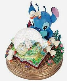 Stitch and ducklings read The Ugly Duckling musical snowglobe