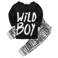 "This two piece clothing set comes with a long sleeve shirt with the quote ""Wild Boy"" on the front and matching pants. The pants are black and white with a unique design."