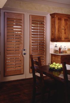 Norman wood door shutter with cutout. Shutters are an unobtrusive solution for french doors. Available at Budget Blinds! Kitchen Shutters, Interior Window Shutters, Window Blinds, French Doors Bedroom, French Door Curtains, Custom Shutters, Vinyl Shutters, French Door Coverings, Window Coverings