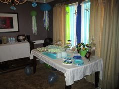 Party Table... Crepe paper curtain, starfish garland. Cake, mini key lime pies, chocolate dipped marshmallows, jellyfish and fishy decorations, hanging bubble garlands, etc.