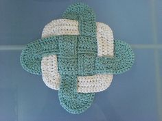 An excellent scrap pattern, this hotpad (Trivet) is crocheted in 3 pieces and then weaved together. In total, one would need about 1 oz of yarn for the outside square and 2 oz of yarn for the two oval sections.