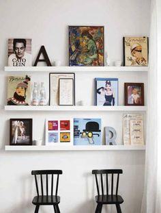 love the leaning frames on narrow shelves