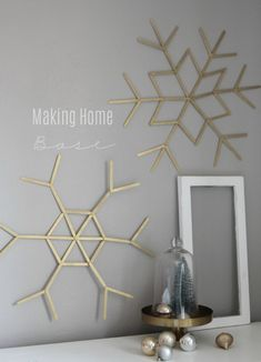 popsicle stick snowflakes are such a cute craft plus they make the most beautiful Christmas wall art.