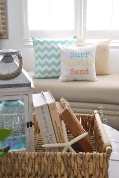 Simple coastal cottage decorating with HomeGoods | Basket gathered goodies make coffee table styling easy. Add some fun pillows and poof, Welcome Summer! sponsored pin foxhollowcottage.com