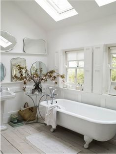 Gorgeous White Bathroom with Clawfoot Tub and Skylights