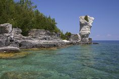 Tobermory, Ontario Canada - I have jumped from these rocks into the icy water - invigorating Beautiful Places To Live, Oh The Places You'll Go, Great Places, O Canada, Canada Travel, Tobermory Ontario, Flowerpot Island, Ontario Travel, Vacation Places