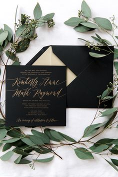 Romantic black and gold wedding invitation suite.