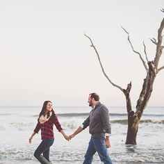 Cute couple walking along the beach in Botany Bay, SC.  Photo by @billiejojeremy. #engaged #engagement #charleston #beach