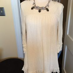Cream button down back top. Cream button down back top. Tunic style, very loose fitting. Would be cute with skinny jeans and heels. Only worn once. Forever 21 Tops Button Down Shirts