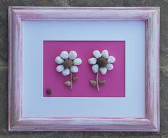 "Pebble Art (Two Precious White Flowers) set on a bright pink background and white matting in an ""open"" 8 1/2 x 11 rustic frame) by CrawfordBunch on Etsy"