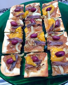 Pissaladière- caramelized onion tart layered w/ anchovies, olives, herbs, Tomato & Fennel