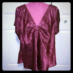 NWOT Magenta Lane Bryant Silky Blouse Beautiful top from Lane Bryant, size 26, bow like detail in the front, black swirly pattern on maroon pink fabric that feels like satin, split short sleeves,  does not stretch  Also on Mercari   Discount on 2+ item bundles! :-) Lane Bryant Tops Blouses