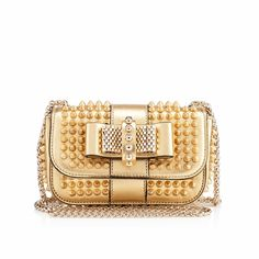 """For the girl with no pockets, our beloved """"Sweety Charity"""" is a perfect fit for all of your evening essentials. In our gorgeous gold specchio leather, this little style is sure to be your most treasured go-to."""