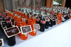 Soda bottles used for wedding place card holders.