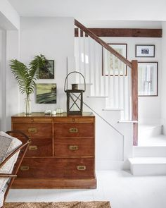 White and wood staircase - cottage tour