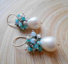 Inspired by nature and lovingly handcrafted, these Eloise pearl cluster earrings are a modern day treasure. Perfect to dress up or wear casually, these feel like a precious offering from the sea. Luminous white freshwater pearls, pale blue apatite, pyrite, baby blue jade and teal