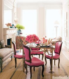 Bright Pink Living Room In the middle of the long, narrow living room, which designer Jonathan Berger broke down into three seating areas, an Italian gilt-brass game table is surrounded by chairs covered in pink leather. The family dines, play board game Long Narrow Rooms, Narrow Living Room, Living Spaces, Living Rooms, Apartment Living, Design Apartment, London Apartment, Small Rooms, Apartment Therapy
